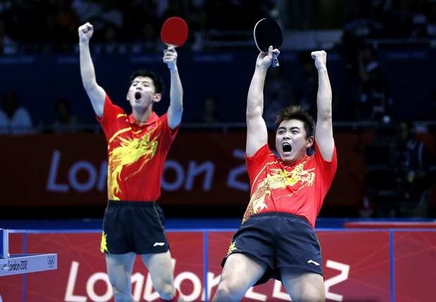 China's Wang Hao, right, and Zhang Jike celebrate their victory in the men's table tennis team gold medal final.