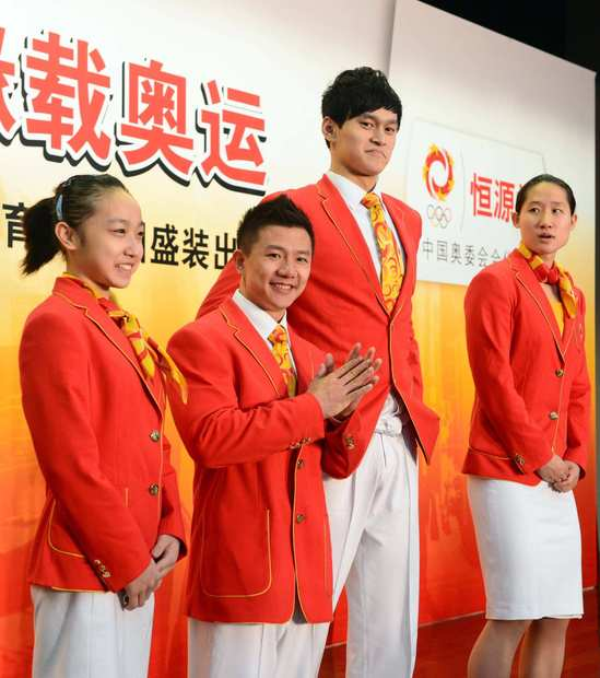 Chinese athletes introduce the bright, crisply tailored uniforms of their Olympic team.