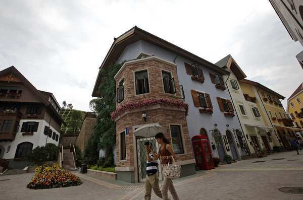 Visitors walk by European-style homes in the Hallstatt development. Reactions to the Chinese replica from Hallstatt residents have been mixed, but an Austrian delegation that included the town's mayor attended the development's opening ceremony.