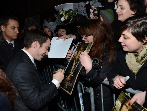"Frodo actor Elijah Wood signs autographs at the New York premiere of ""The Hobbit: An Unexpected Journey."""