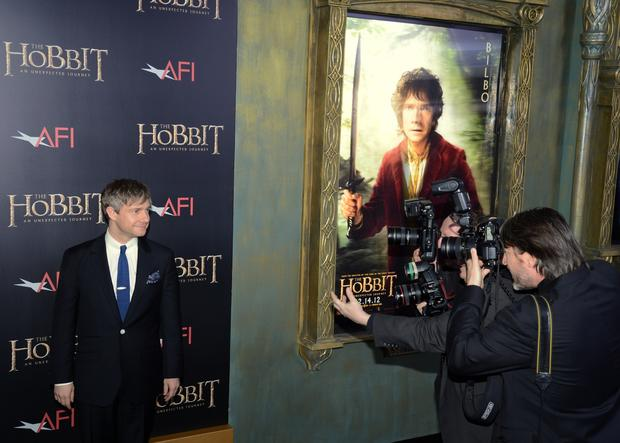 "Bilbo Baggins actor Martin Freeman poses for photographers at the New York premiere of ""The Hobbit: An Unexpected Journey."""