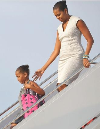 After a weekend visit to to Montana, Wyoming, Colorado and Arizona, Michelle Obama and daughter Sasha disembark from Air Force One at Andrews Air Force Base in Maryland.