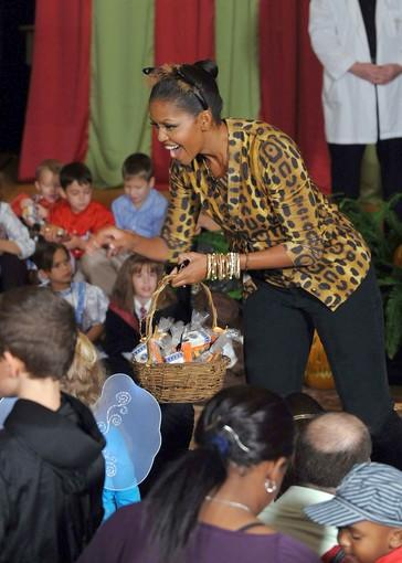 "She even makes a statement in a Halloween costume. Michelle Obama is spotted in the popular <a href=""http://latimesblogs.latimes.com/alltherage/2009/09/video-animal-print-is-spoton-for-fall.html"">animal-print trend</a> as she hands out candy to White House trick-or-treaters."