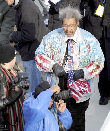 Boxing promoter Don King walks the crowd before the inauguration.