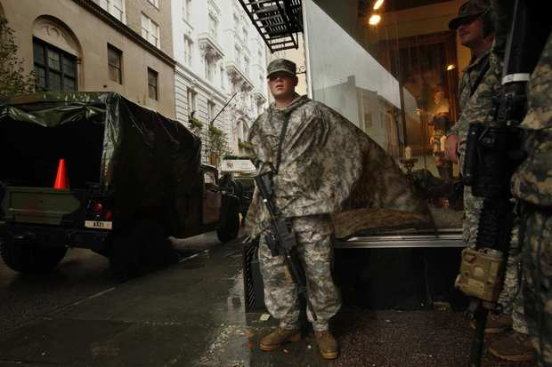 Members of the National Guard stand watch in the French Quarter of New Orleans as Isaac continued to bring high winds and rain to the city.