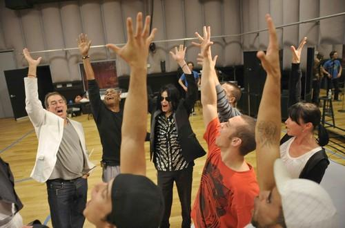 "Choreographer/director Kenny Ortega (L) and Michael Jackson (C) rehearse for the ""This Is It"" tour."