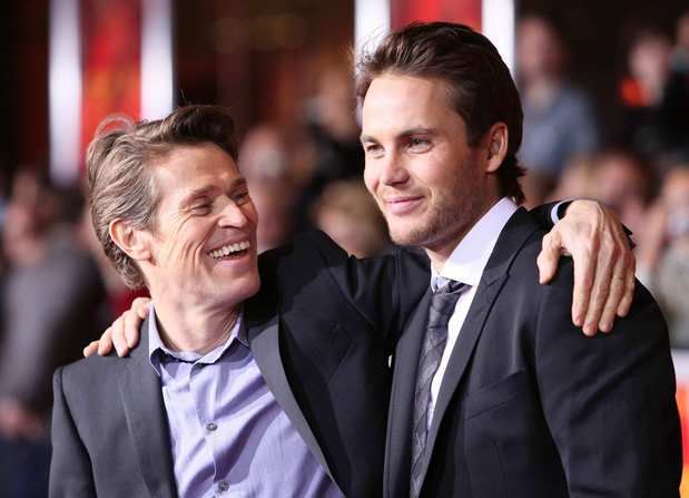 """John Carter"" stars Willem Dafoe, left, and Taylor Kitsch."