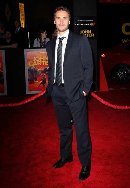 "Taylor Kitsch  walks the red carpet at the ""John Carter"" premiere."
