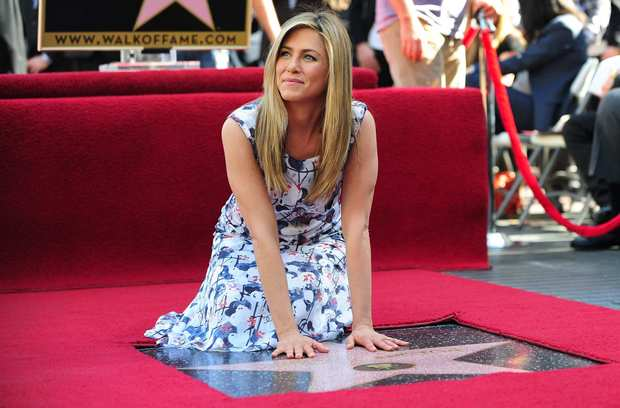 Jennifer Aniston was surrounded by friends and family on Wednesday as she received her star on the Hollywood Walk of Fame. Among those in attendance were boyfriend Justin Theroux, Adam Sandler, Malin Akerman and dad John Aniston.