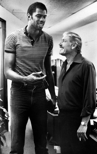 Jerry Buss greets Lakers center Kareem Abdul-Jabbar during a meeting in the offseason.