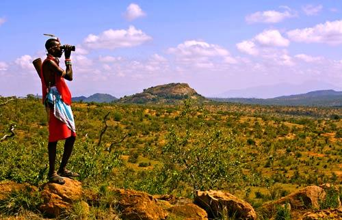 "Ngasakwe ""Gus"" Kipise, a Samburu warrior and guide, keeps watch for wildlife on a walking safari in Kenya."