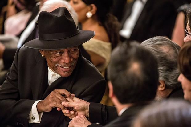 Actor Morgan Freeman greets another guest.