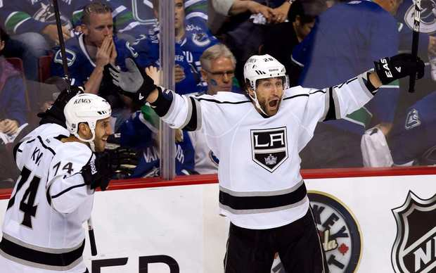 Kings center Jarret Stoll, right, celebrates alongside teammate Dwight King after scoring in overtime to lift the Kings to a 2-1 victory over the Vancouver Canucks in Game 5 of the Western Conference quarterfinals.