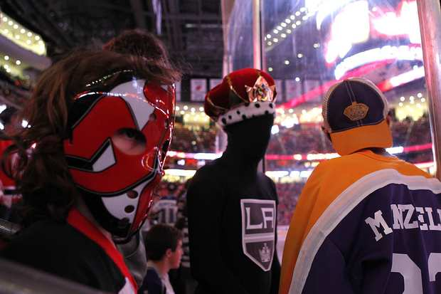 Devils fan Angelo Lemontani, 8, stands near the enemy as the Kings and Devils warm up for Game 2 of the Stanley Cup Final on Saturday at the Prudential Center in Newark, N.J.