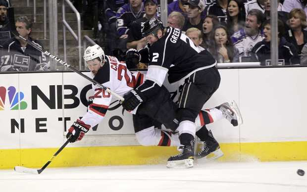 Kings defenseman Matt Greene (2) collides with Devils center Ryan Carter along the boards in the first period of Game 6 on Monday evening at Staples Center.
