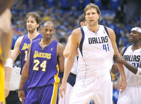 Lakers center Pau Gasol, left, and guard Kobe Bryant, center, walk away from Dallas center Dirk Nowitzki after he is fouled during Game 3 of the Western Conference semifinals on May 6, 2011. Nowitzki, who went on win NBA most valuable player honors for the NBA champion Mavericks, played a leading role in knocking the Lakers out of the playoffs.