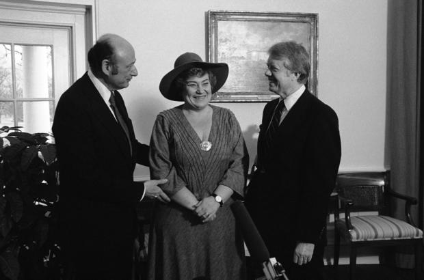 New York Mayor Ed Koch, left, and former Rep. Bella Abzug, D-N.Y., center, chat with President Jimmy Carter during a meeting in the Oval Office in Washington.