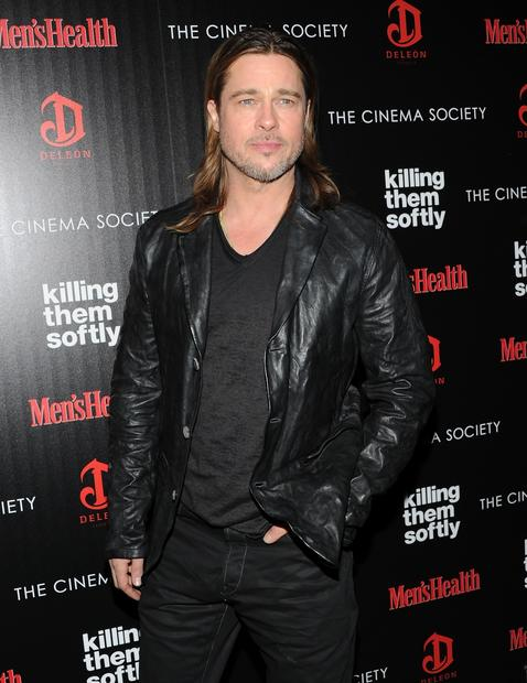 "Brad Pitt plays an enforcer who likes to kill his marks from a distance, or ""softly,"" hired to investigate a heist of a mob-protected card game."