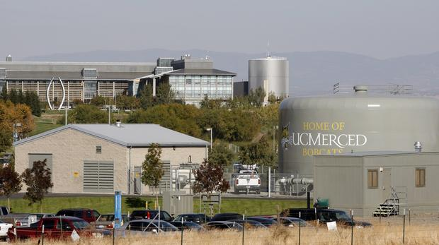 The campus of the UC Merced viewed from farmland surrounding it.