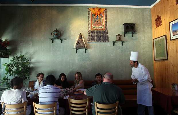 Chef Chudamani Adhikari checks on customers at Himalayan Cafe in Old Pasadena.