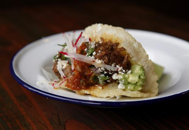 Carne guisada (stewed beef) puffy tacos from Bar Amá, a Tex-Mex restaurant downtown.