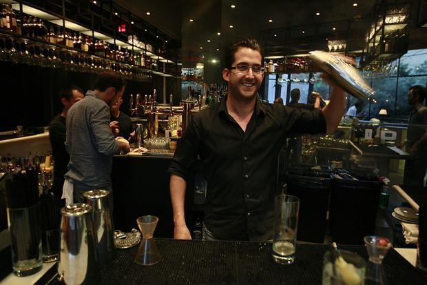 Laurel Hardware bartender Cole Apodaca mixes a drink.