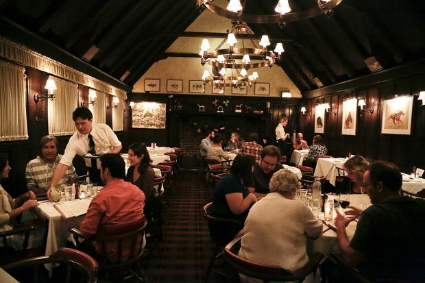 The main dining room at Tom Bergin's Tavern looks like the kind of place you'd see Raymond Chandler.