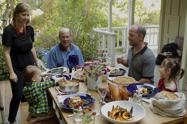 Chefs Karen and Quinn, second from right, Hatfield, children Bennett, left, and Paige, and father-in-law Larry at the table at the Hatfields' Laurel Canyon home.