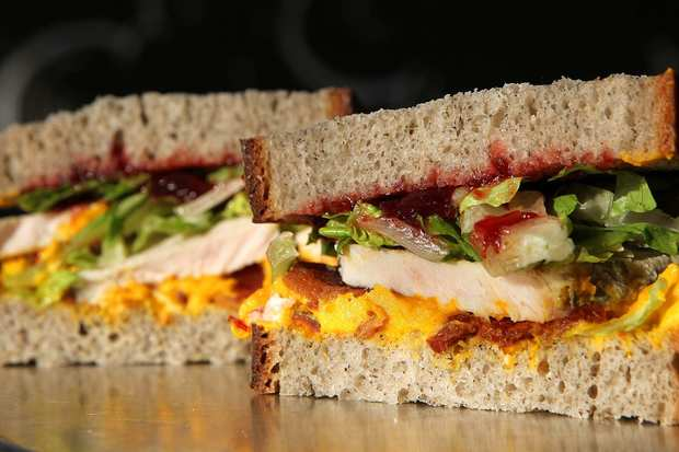 "A turkey sandwich made with buckwheat bread, kabosha squash whipped with creme fraiche, applewood smoked bacon, hot carved turkey, romaine, and cranberry chutney prepared at Mendocino Farms in West Hollywood. <a href=""http://www.latimes.com/features/food/la-fo-sandwich1-rec1-20111124,0,1974112.story"">Recipe</a>"