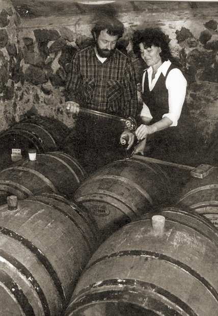 In the barrel room at Ponzi Vineyards in the Willamette Valley region of Oregon in the 1980s, Dick and Nancy Ponzi check barreled wines.