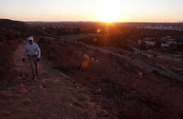A hiker uses one of the trails at the Baldwin Hills Scenic Overlook State Park, at sunset.