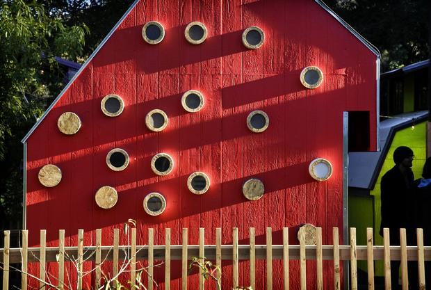 The miniature cabins were built at the Shadow Hills Riding Club, which will use them as part of an equestrian therapy program. The Woodbury students assigned to build a music-themed cabin painted their design red in homage to traditional barns, team member Angela Isayan said. For more on the function of the portholes, keep clicking …