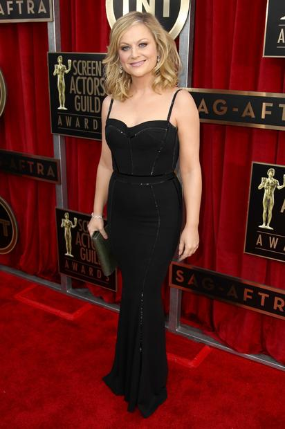 Designer Zuhair Murad had a decidedly more low-key moment on the red carpet tonight than at the Golden Globes. Amy Poehler's simple black jersey gown is a 180 from Jennifer Lopez's Globes gown, a blush-colored lace style that was about as sheer as you can get without risking an FCC fine.