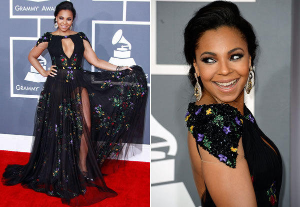 And then along came Ashanti in a Tony Ward Couture gown.  The embroidered black lace may have looked innocent enough, but that keyhole of cleavage and slit to the hip were pushing the bounds -- in terms of propriety, yes, but mostly taste.