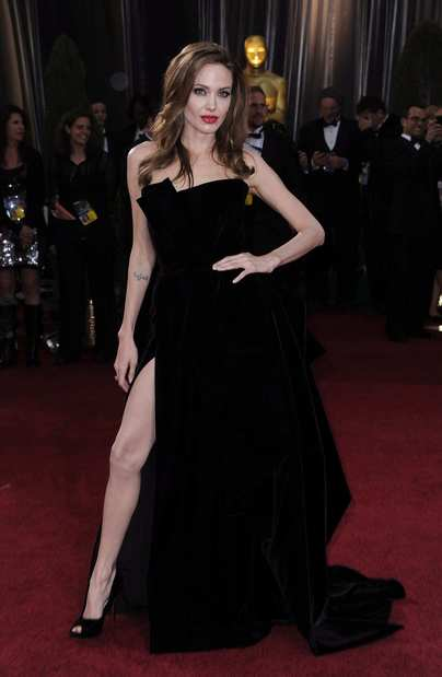 Angelina Jolie's black velvet Atelier Versace gown, slit thigh-high, was as smoldering, high-drama as fashion can get on the red carpet.