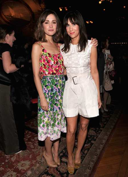 Rose Byrne and Kristen Wiig (R) attend the Marc Jacobs show.