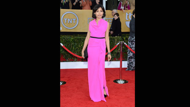 Freida Pinto's shocking pink draped Roland Mouret gown had the surprising detail of flirty black bows in back. Pinto is also wearing killer black Roger Vivier Papillon heels.