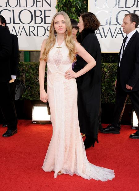 Amanda Seyfried's cream lace Givenchy gown was so subtle in color and detail, it made the fair-haired actress fade into the background.