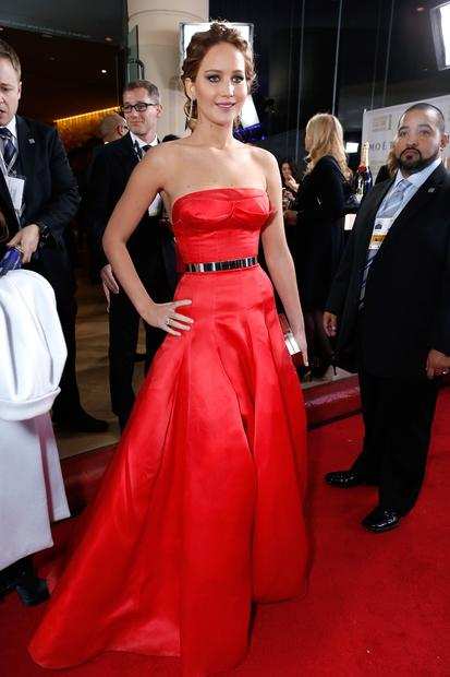 Jennifer Lawrence's Dior coral-red silk organza gown with molded bodice did not fit her properly, and the wrinkled skirt could have used a steaming.