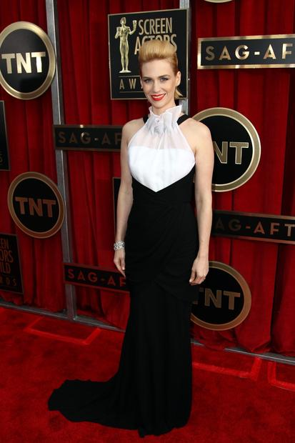 The biggest risk taker of the night: January Jones, wearing a black-and-white Prabal Gurung gown with an intriguing sheer, scarf-like effect at the neck. Her blond hair was swept into a punky pompadour-mullet like David Bowie from his Aladdin Sane days. It was totally rockin'.