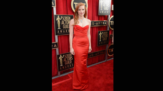 Jessica Chastain's strapless red Alexander McQueen gown fits her like a glove, and the color works well with her hair. But somehow, it's just meh.
