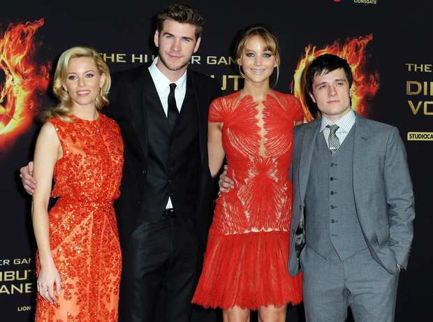 "Jennifer Lawrence, second from right, and Elizabeth Banks, left, Liam Hemsworth and Josh Hutcherson arrive for the premiere of ""The Hunger Games"" in Berlin."