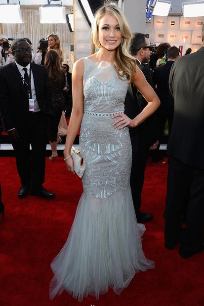 "Hollywood has gone crazy for mermaids. Katrina Bowden (""30 Rock"") is wearing a celadon green tulle and chiffon fishtail gown by Badgley Mischka."