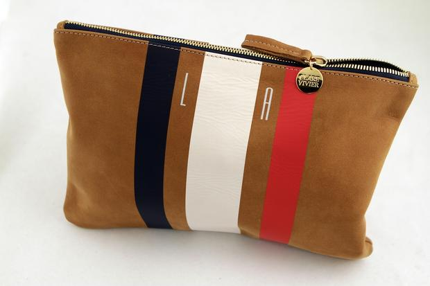 "Clare Vivier striped leather zip clutch with monogram, $184 at <a href=""http://www.clarevivier.com"">Clarevivier.com</a>."