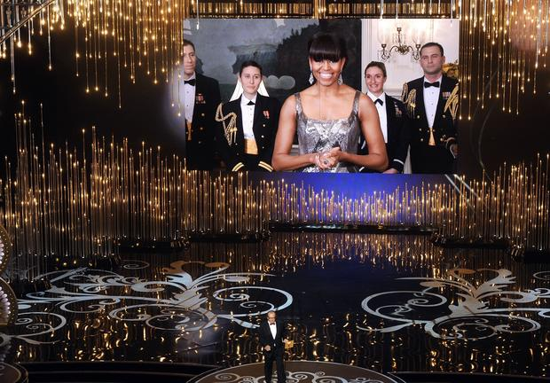 First Lady Michelle Obama, the evening's surprise guest brought in via satellite, made the ultimate sparkly style statement in an Art Deco-inspired Naeem Khan gown.