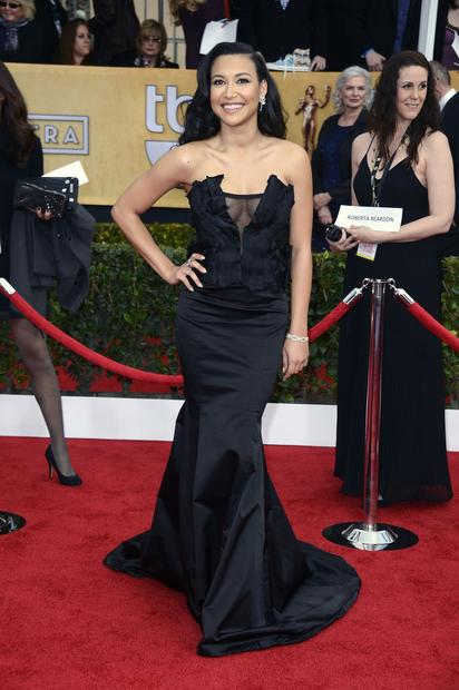 """Glee"" star Naya Rivera is all over the sheer trend, wearing a black satin corseted Donna Karan gown with sheer accordion pleating across the decolletage. It's a lot to take in."