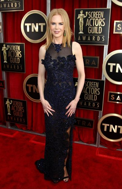 Nicole Kidman is wearing an anything-but-basic-black, sheer Vivienne Westwood gown with delicate floral embroidery on the front.