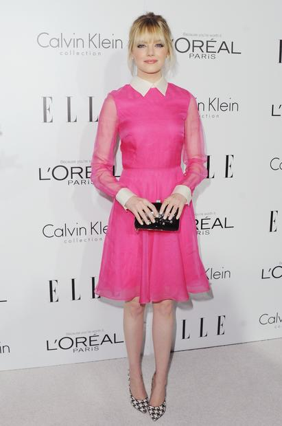 Emma Stone is pretty in pink Valentino dress with sheer sleeves, contrasting collar and cuffs.