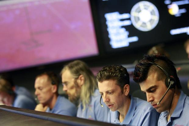 The frenzy surrounding the historic landing of NASA's Mars rover Curiosity was nearly eclipsed by the instant Internet celebrity of Bobak Ferdowsi (far right), the mohawk-haired flight director at the Jet Propulsion Laboratory in Pasadena. (August)