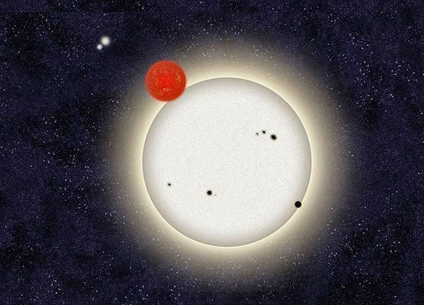 A drawing of the planet PH1 with its four suns.
